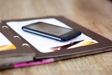 Diary with mobile phone on top