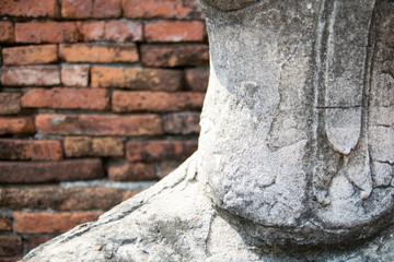 Old Buddha statue with brick wall pattern background