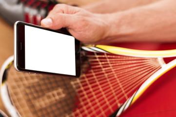 Squash rackets and black phone - Stock Image