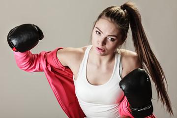 Feminist woman training, boxing.