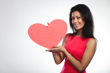 Girl mixed race with paper red heart