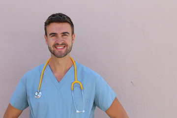 Male nurse in scrubs with stethoscope smiling