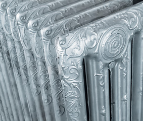 Close-up of a vintage decorated steel radiator