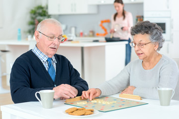 Senior couple playing a board game