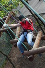 Climber sitting on log