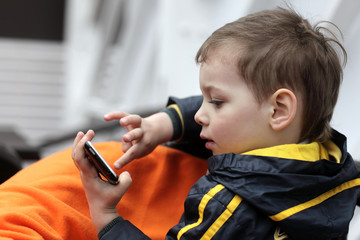 Boy playing with smartphone