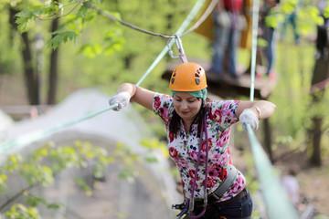 Person climbing at adventure park
