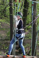 Teen climbing at adventure park