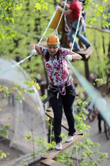 Woman at adventure park in forest