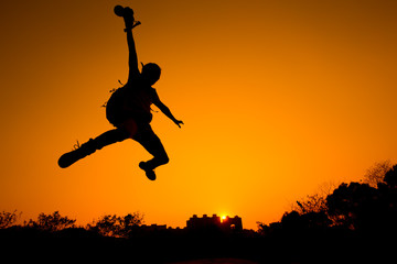 Silhouette of Man jumping - color tone tuned