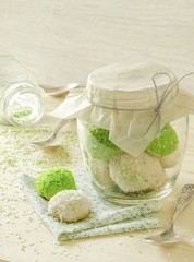 Sugar cookies with coconut flakes in glass jar