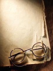 Vintage glasses on old paper