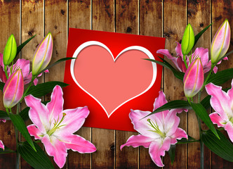Card with heart and pink Lily flower on wooden board