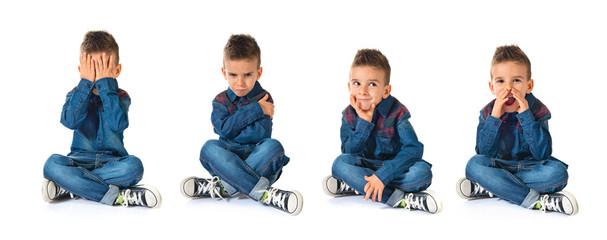 Sad kid over white background