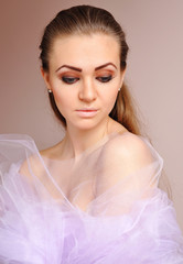 Fashion photo of beautiful woman in lilac veil