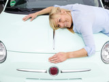 Woman loves and cherishes her car poster