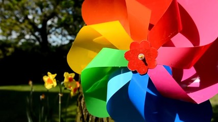 Tracking shot of the decorative swirling colorful pinwheel.