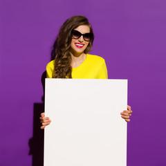 Smiling Fashion Girl Holding White Paper Sheet
