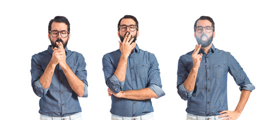 Young hipster man smoking over white background
