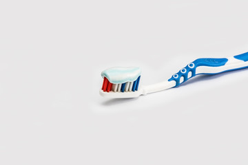 toothbrush with toothpaste for oral hygiene