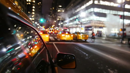 Yellow cabs driving in Manhattan