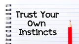 Trust Your Own Instincts Text written on notebook page poster