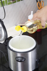 Chef pouring vegetable oil