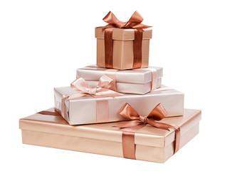 Beautiful golden brown boxes with bows isolated on white backgro