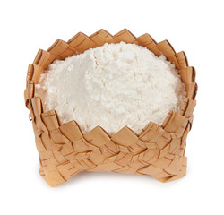 Fresh flour isolated in a wicker basket