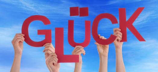 People Hold German Word Glueck Means Luck Blue Sky
