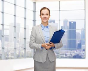 smiling businesswoman holding folder