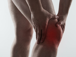 Red spot on painful male knee. Man having rheumatism problem