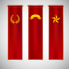 Vertical red flags with emblems.