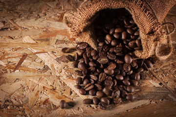 bag with coffee beans isolated on the wooden background