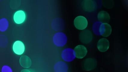 Blinking bokeh lights on dark background
