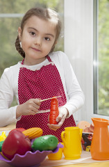 Little girl play cooking
