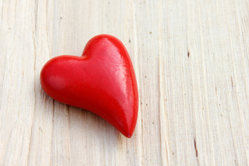 Heart and wooden background