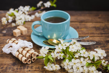 wafers, tea and flowers of cherry