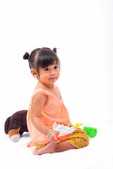 Asian girl with Thai traditional dress playing with toy