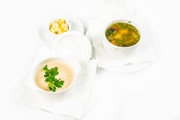 Bowl of soup with croutons on white background
