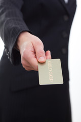 Businesswoman holding a gold card