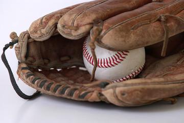 baseball glove and balls on white background