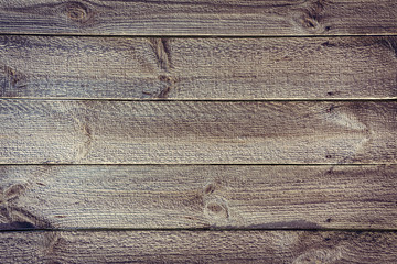 crude fence from horizontal wooden boards with nails