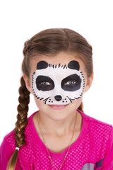 Young girl wearing panda carnival face paint isolated on white