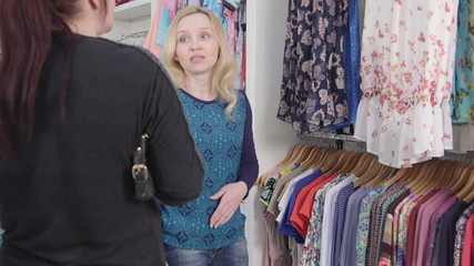 Shopping for pregnancy clothes in baby and maternity store