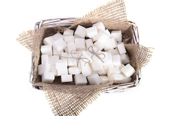 White refined sugar is a bunch in a basket