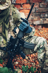 soldier holding  weapon M4 carbine