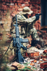 soldier with rifle in the ruins