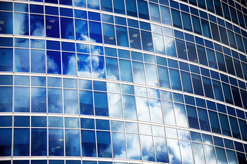 Reflections in blue windows in an office building