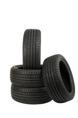 new sport summer tires stacked, over white, studio shot